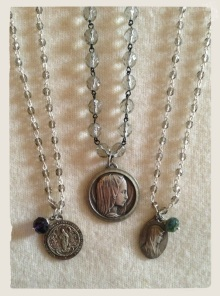 Sacred Heart medal, France, 1800s (left) Lourdes medals, 1930s (middle, right). Necklaces designed by Jen Westmoreland Bouchard, Litany Jewelry Designs