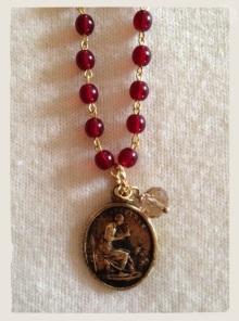 Brass St. Geneviève medal, France, early 1800s. Necklace designed by Jen Westmoreland Bouchard, Litany Jewelry Designs